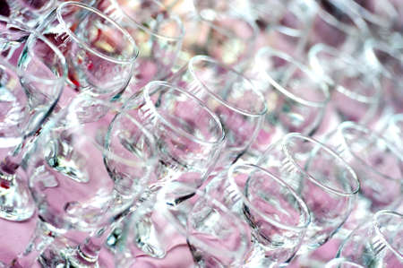 Empty clean transparent wine glasses standing in restaurant on pink tablecloth Stok Fotoğraf