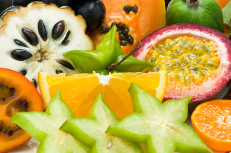 Fresh exotic tropical fruits with slices, healthy food, vegetarian diet nutrition, selective focus Stok Fotoğraf