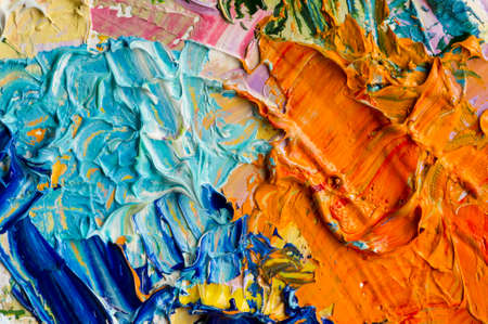 Artist palette with mixed oil paints, macro, colorful stroke texture on canvas, studio shot, abstract art background Reklamní fotografie