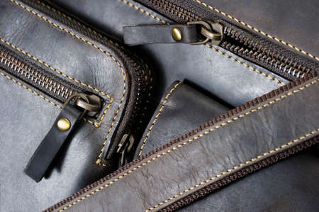 Leather bag with zipper, pocket and stitches, man accessories in vintage style, macro shot, selective focus