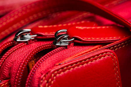 Red leather bag with zipper, shoulder strap and stitches, woman accessories, fashion industry, macro shot, selective focus Stock fotó
