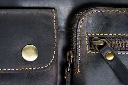 Leather bag with zipper, magnetic clasp on pocket and stitches, man accessories in vintage style, macro shot, selective focus