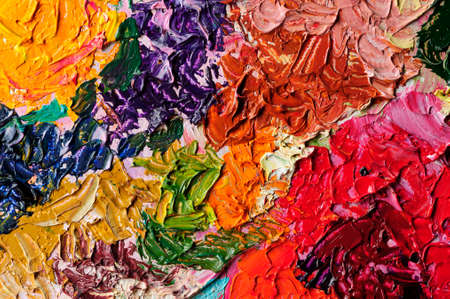 Oil paint mixed on canvas, artist palette, art and hobby concept, studio shot, colorful abstract textured background Reklamní fotografie