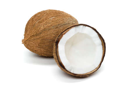 Coconut, whole exotic tropical nut with half isolated on white background, healthy food, diet nutrition