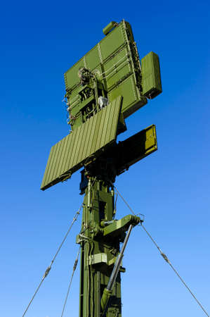 Air defense radar of military mobile antiaircraft system in green color, modern army industry, blue sky on background
