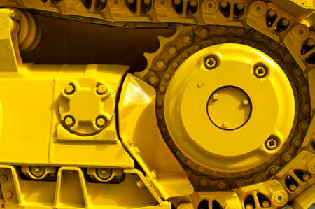 Track drive gear, bulldozer sprocket mechanism, large yellow construction machine with bolts, heavy industry, detail 版權商用圖片