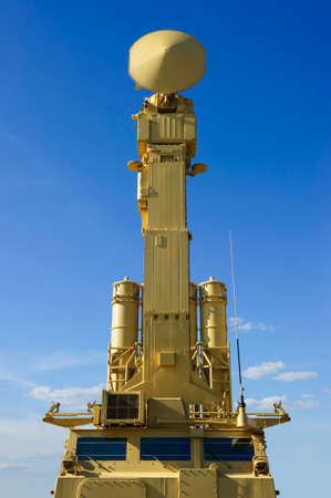 Air defense radar of military mobile mighty missile launcher system of beige color, modern army industry, white cloud and blue sky on background 版權商用圖片