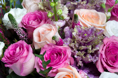 Flower bouquet, bunch of pink and peach roses, white lisianthus, red veronica spicata or garden speedwell and green eucalyptus, springtime concept, selective focus Zdjęcie Seryjne