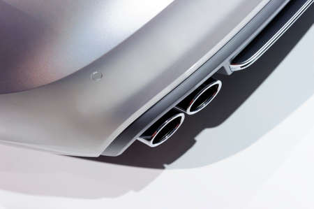Double chrome exhaust pipe of sport car with silver metallic bodywork, automobile industry, selective focus Zdjęcie Seryjne