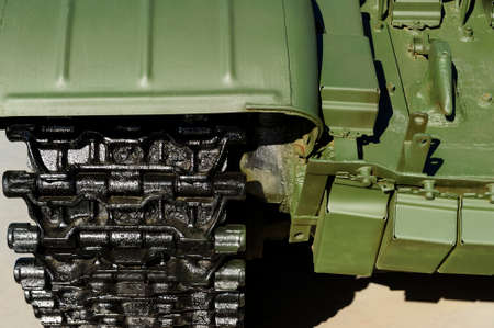 Part of military tank with tracks, armored vehicle with green bodywork, modern army industry