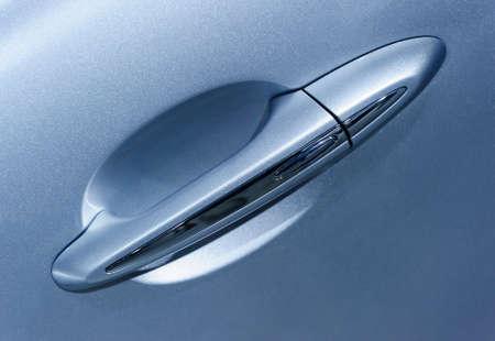 Car handle of vehicle door, detail of blue metallic bodywork, sport powerful sedan, automobile industry, selective focus