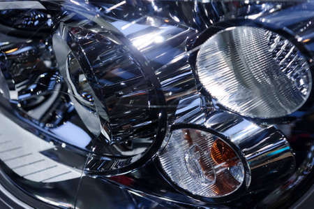 Headlight of big suv, abstract detail of car light equipment, automobile industry, selective focus Standard-Bild