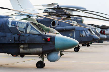 Helicopters and planes in row, military copters and reconnaissance aircrafts, air force, modern army aviation and aerospace industry