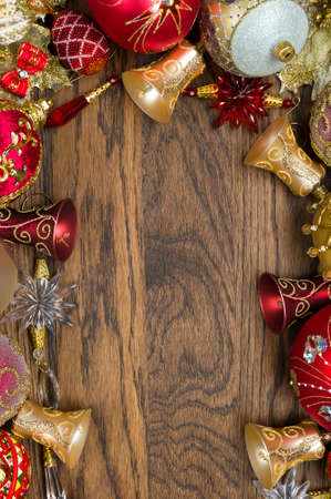 Christmas decoration ornament, new year toys of red and gold colors on wooden background, winter holidays and celebrations concept 写真素材