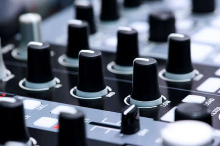 DJ mixer controller, fader and buttons of cool silver vinyl mixing console in nightclub, nightlife and entertainment, music industry, selective focus