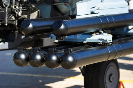 Missile launcher under wing of military helicopter ready to attack, antitank weapon, air force of modern army, aviation and aerospace industry, selective focus Standard-Bild