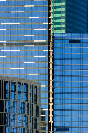 Skyscrapers, office buildings in business center of city, modern glass architecture in commercial downtown, future design abstraction