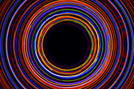 Rotating neon lights, spinning bright colorful laser lights background, modern nightlife and party concept, disco and dancing nightclubs pattern Standard-Bild