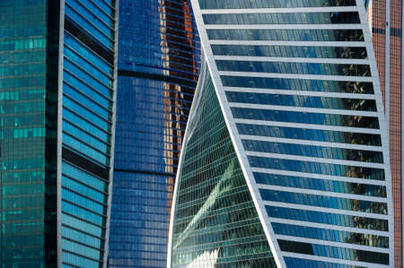 Skyscrapers, office buildings in business centre of city, modern glass architecture in commercial downtown, future design abstraction