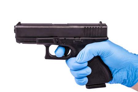 Hand in blue latex with aiming handgun