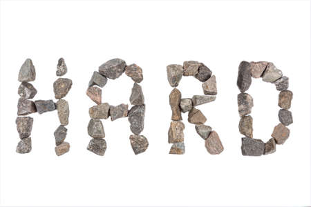 word Hard made with small rocks on white background Stock Photo