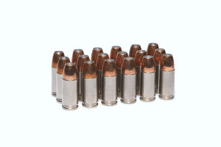 9mm: 9mm ammo bullets in light background Stock Photo