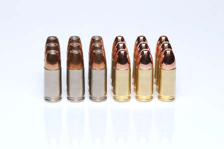 9mm ammo: 9mm ammo bullets in light background Stock Photo