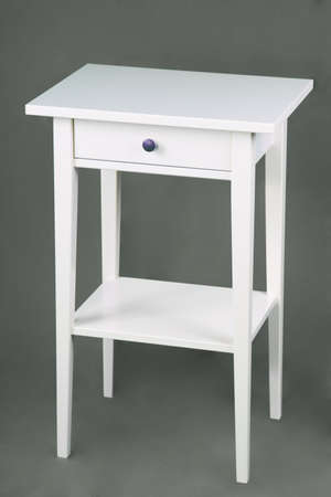 White bedside-table on gray background