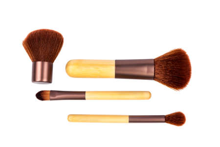 Wooden cosmetic brushes on white background  Isolated