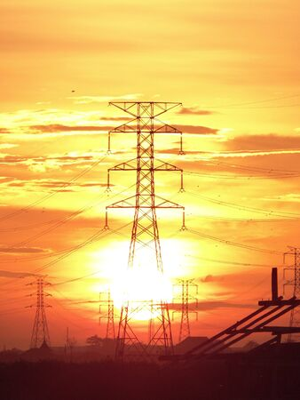 volts: electric tower at sunrise Stock Photo