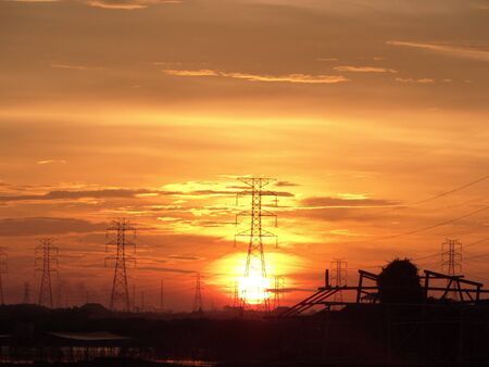 volts: Electric Power Transmission Lines at sunrise