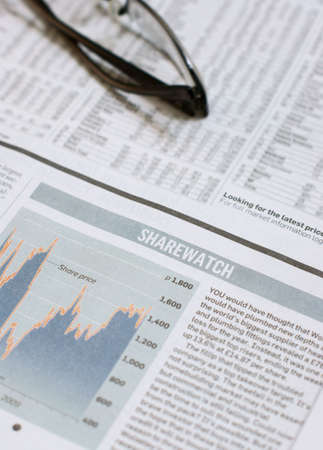 Share prices in the newspaper Stock Photo