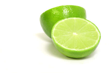 Green Limes on White on an isolated background Stock Photo