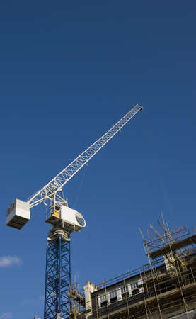 Crane on building site with blue sky