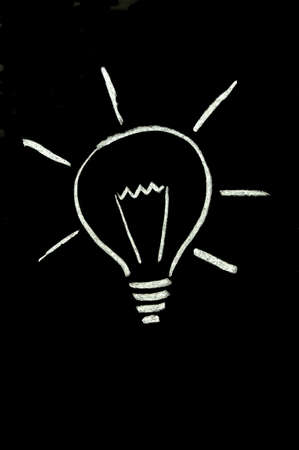 Chalk lightbulb on blackboard