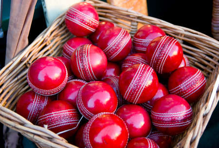Cricket Balls in a basket on a market stall