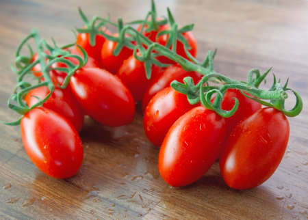 Ripe red tomatos with selected focus