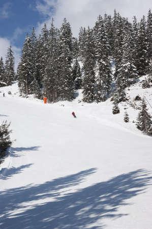 An Alpine Skier on Swiss ski resort piste