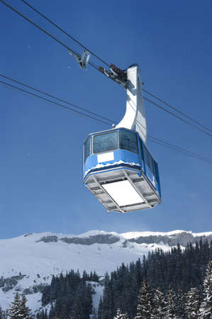 Cable car with specs of snow in Switzerland Alps