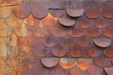 Rusty cladding on old Swiss building in Champery