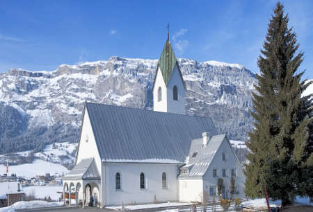 Swiss church in Flims Laax set against mountains and snow Stock Photo - 6810383