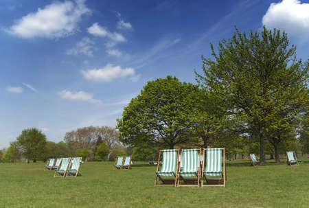 Deckchairs in Hyde Park, London in summer