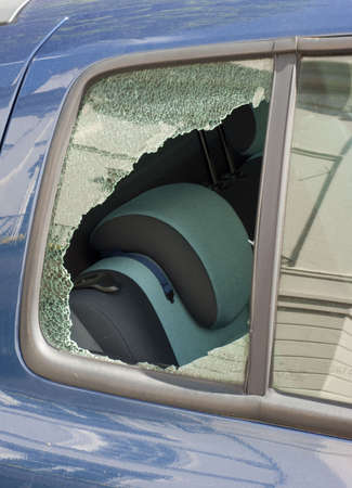 Car window smashed in crime incident photo