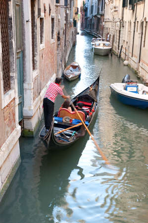 Venice Canal with Gondolier navigating the water