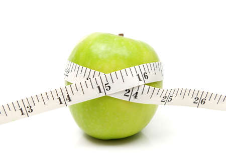 whote: Green apple with tape on whote background Stock Photo