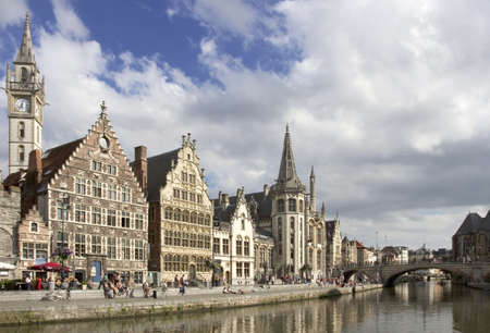 Ghent Graslei on the waterfront in Belgium with tourists sunbathing
