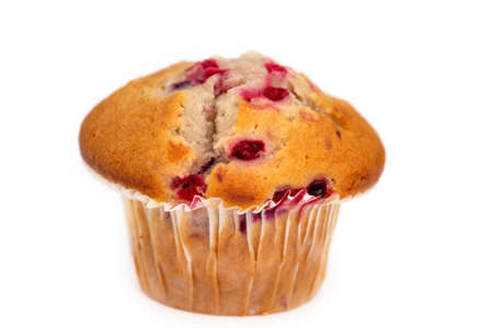Single fresh muffin on white background with short depth of field. Stock Photo