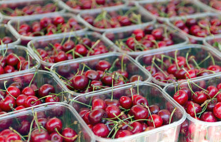 Punnet of cherries on a market stall