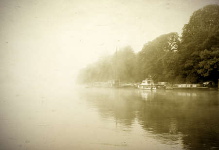 old fashioned sepia: Morning mist on a river