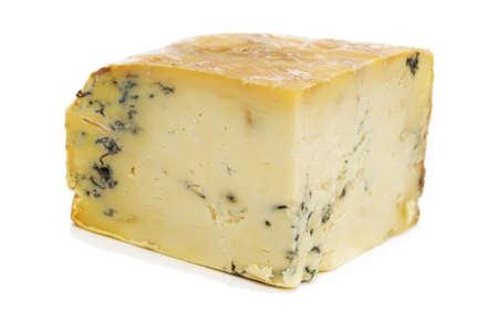 stilton: Block of Stilton Cheese on a white background.